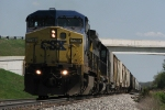 CSX 7798 leads Q335-04 westbound under the overpass 